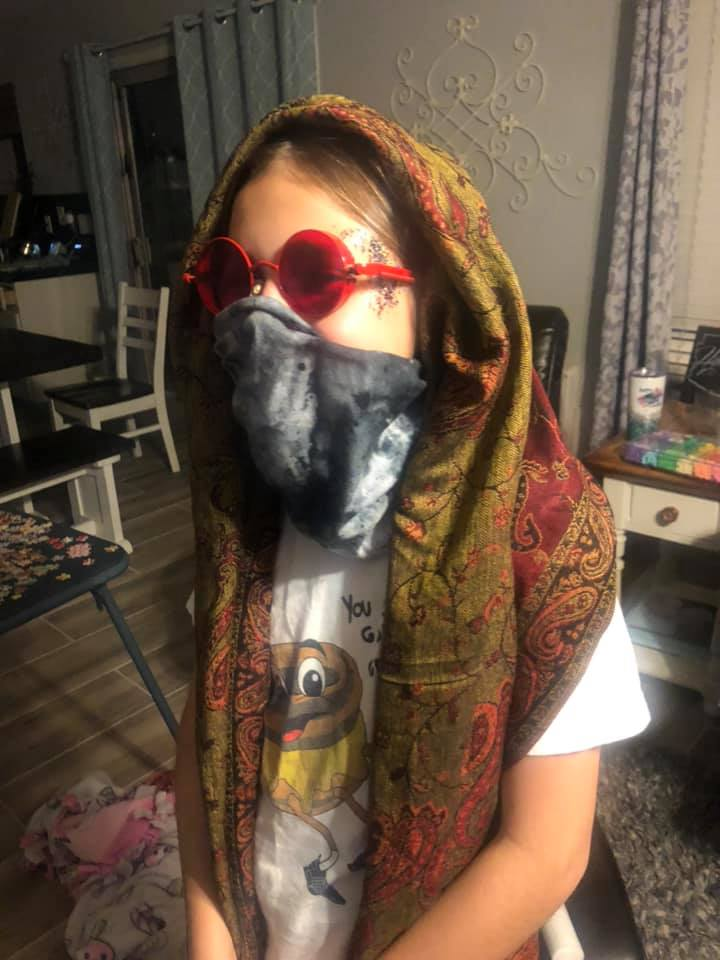 A young kid dresses up in pink glasses for a Beyond Wonderland Virtual Rave-a-Thon