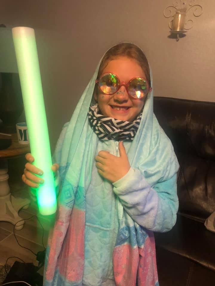 A young kid dresses up with fractal glasses Beyond Wonderland Virtual Rave-a-Thon